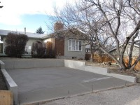 Garage pad with 3 foot curb wall stepped down calgary